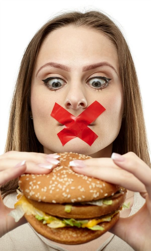 girl with hanburger with tape over her mouth